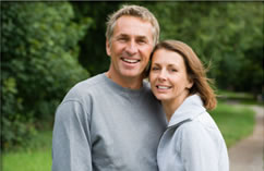 A smiling couple with dental bridges